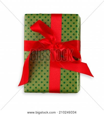 Gift box wrapped in dotted green paper and red satin ribbon, isolated on white background. Modern present for any holiday, christmas, valentine or birthday