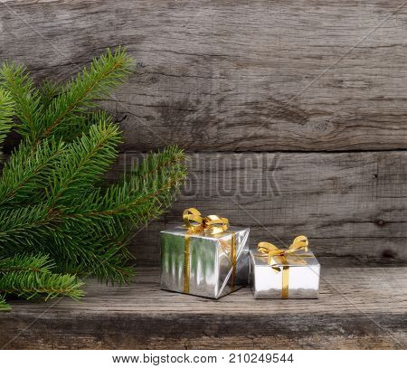Christmas Tree and gift boxes on wooden background
