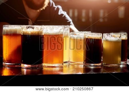 Assorted beers for tasting. Different sorts of draft beers. Set of alcoholic beverage.