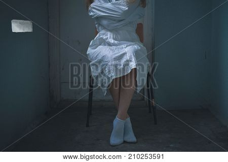 mentally ill girlwith a straitjacket in a Psychiatric