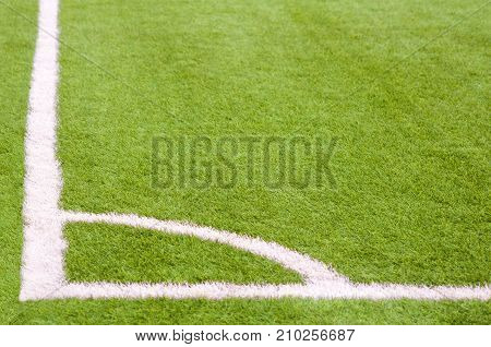 Soccer ground, detail of the corner with lines and grass