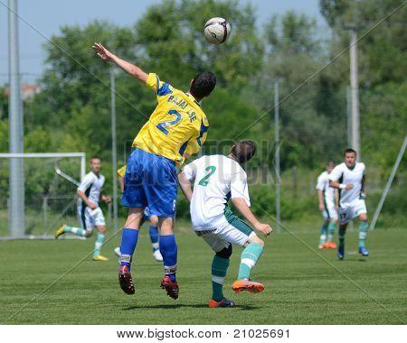 KAPOSVAR, HUNGARY - JUNE 11: Erik Judak (in yellow) in action at the Hungarian National Championship under 13 game between Kaposvari Rakoczi FC and Bajai LSE on June 11, 2011 in Kaposvar, Hungary.