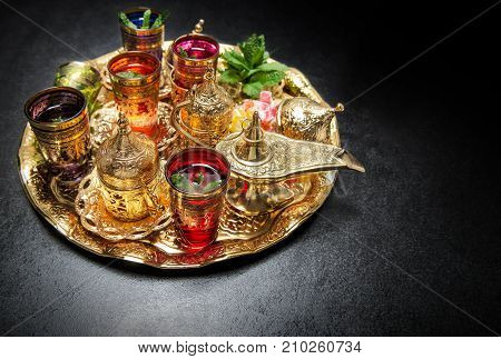Golden tea table decoration. Arabic traditional dishes. Ramadan kareem poster