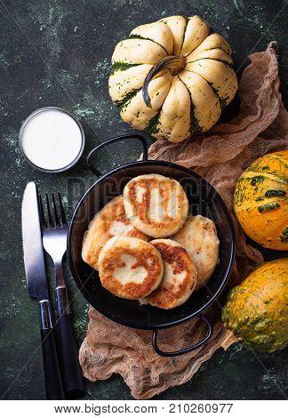 Delicious homemade pumpkins pancakes. A selective focus