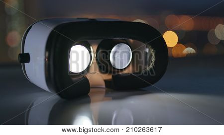 Virtual reality device playing video inside at night