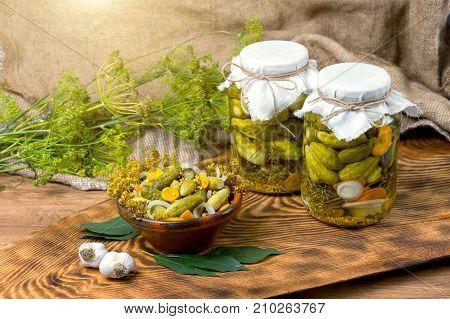 Pickled cucumbers marinating in jars cucumbers in a bowl Cucumber pickle set