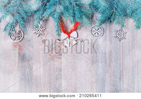 New Year and Christmas background. Christmas toys blue fir tree branches on the wooden background. New Year and Christmas still life. New Year and Christmas festive card with New Year concept. New Year and Christmas festive background