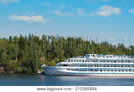 Island Valaam Russia - September 6 2017: White cruise ships are in the Bay of the island of Valaam. Nicholas Bay. in Valaam Russia