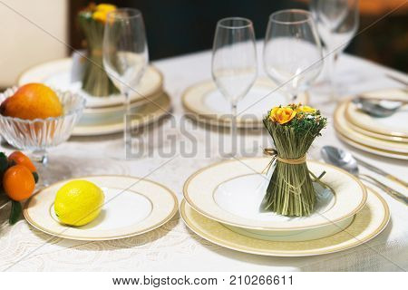 Beautiful table set with flowers for a festive event party or wedding reception