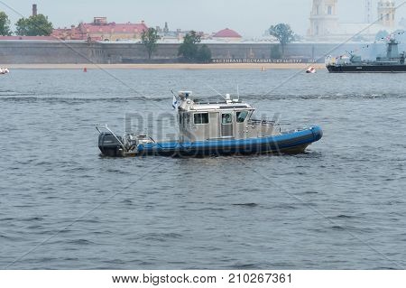 ST PETERSBURG RUSSIA - JULY 28 2017: A patrol vessel in the water area of the Neva River in St. Petersburg Russia