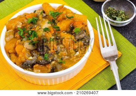 Vegetable stew with pumpkin and champignons. Studio Photo