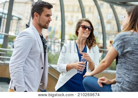 Young businesspeople standing on the street talking .