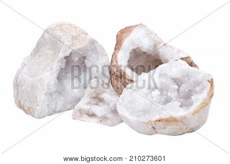 Collection of clear crystal quartz geodes with crystalline druzy center isolated on white background