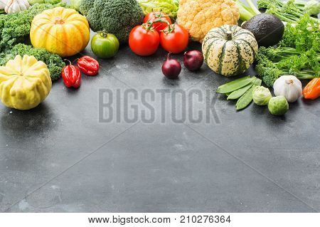 Above view of vegetables on the dark grey black background, copy space for text below, selective focus