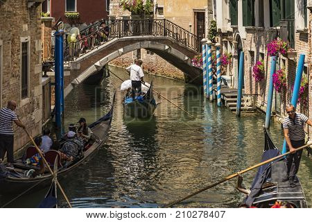 VENICE - JULY 1: beautiful view of the canal with a floating gondola on July 1, 2017 in Venice, Italy