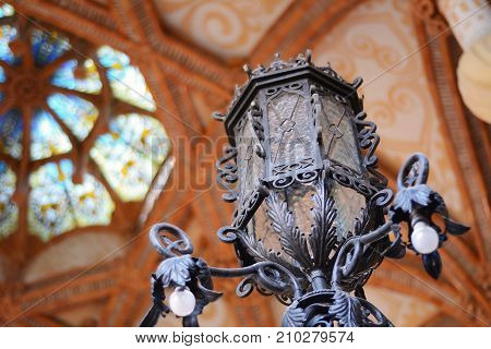 Old lantern against beautiful glass roof. Travel concept