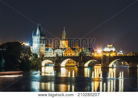 View Of  Charles Bridge And Vltava River At Night In Prague, Czech Republic