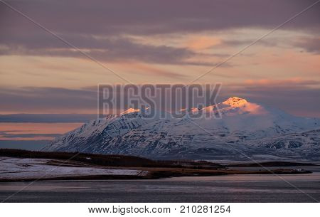 Winter landscape in rural area in Iceland, at morning sunrise