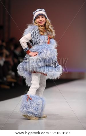 MOSCOW - FEBRUARY 22: A child model wears fashions from Snowimage and walks catwalk in Collection Premiere Moscow, main platform of fashion industry in Eastern Europe, on February 22, 2011, Moscow, Russia