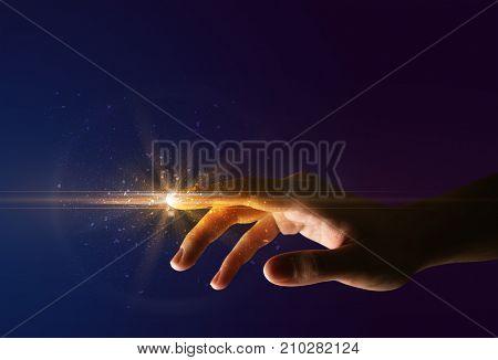 Female finger touching a beam of light