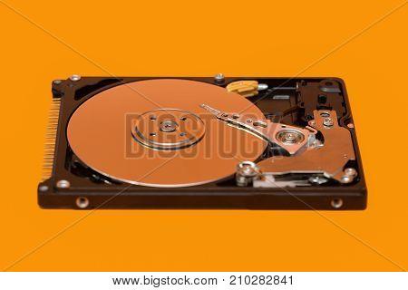 Hdd. Open Hard Disk On Orange Background