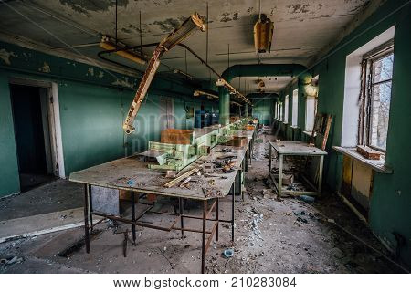 Abandoned and ruined workshop at abandoned factory of radio components