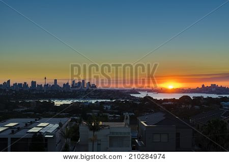 Sydney Harbour and CBD at sunset, with view of Harbour Bridge and Opera House