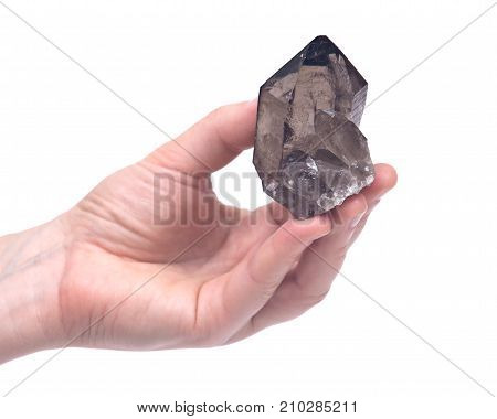 Woman's hand holding high altitude Smokey quartz (Gwindel quartz) from the Swiss mountains, isolated on white background poster