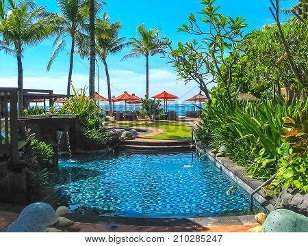 Nusa Dua, Bali, Indonesia - April 12, 2012: View of swimming pool at St. Regis Bali Resort