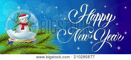 Happy New Year calligraphy with snow globe on fir branch over blue background with bokeh. Holiday, celebration, festivity. Party concept. Can be used for greeting cards, posters, leaflets and brochure