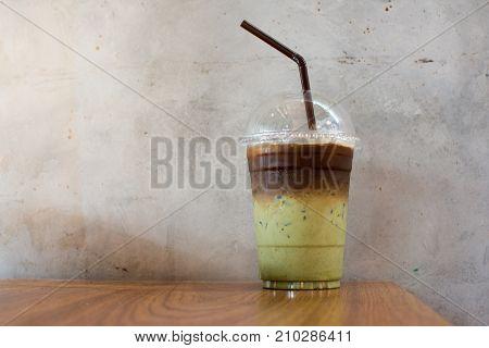 Matcha Green Tea ice Latte on wood table.