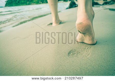 The woman's feet are running down to the sea Concept sea.