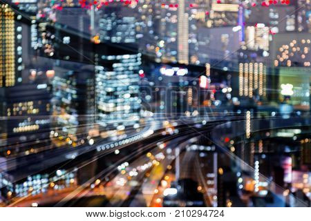 Moving traing track motion blurred double exposure city night blurred bokeh light abstract background