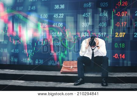 Tired Or Stressed Businessman Sitting On The Walkway In Panic Digital Stock Market Financial Backgro