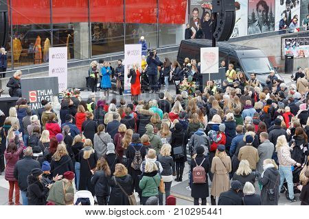 STOCKHOLM SWEDEN - OCT 22 2017: Lots of people supporting the #metoo compaign against sexual harassment at Sergels torg in Stockholm. October 22 2017 Sweden