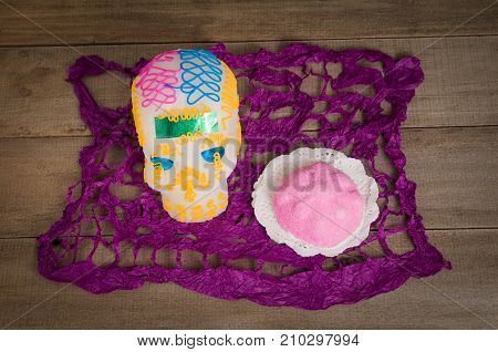 Skull and Dead Bread made with sugar paste by mexican artisans. They are used to adorn the homes and offerings of altars during the festivities of the Day of the Dead on November 1 and 2. They are considered to be typical sweets from Mexico and although n
