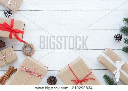Christmas composition - Christmas present gifts box and decoration elements on white wooden background. Creative Flat layout and top view composition with border and copy space design.