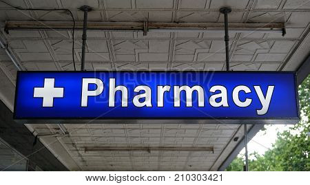 Unspecified universal Pharmacy neon sign above the entrance to the chemist drug store