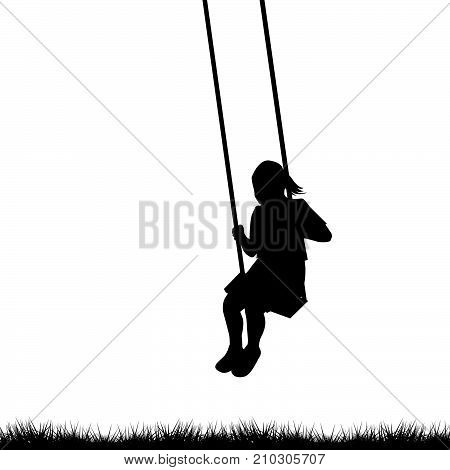 Child having fun on a swing outdoor