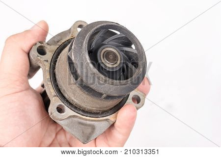 Old Used Dirty Car Water Pump In The Hand Above White Background