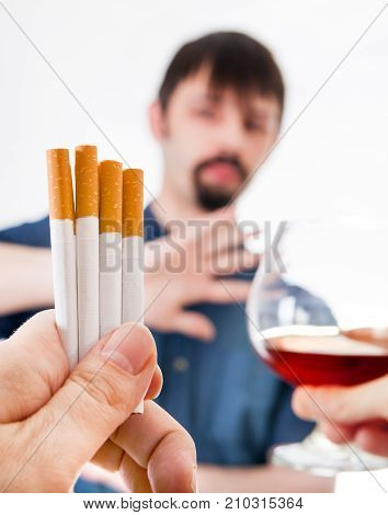 Man refuse Cigarettes and Alcohol on the White Background