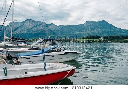 Mondsee, Austria - August 5, 2017: Boats moored in a pier in Mondsee. Mondsee is a lake in the Upper Austrian part of the Salzkammergut. It is one of Austria's last privately owned lakes.
