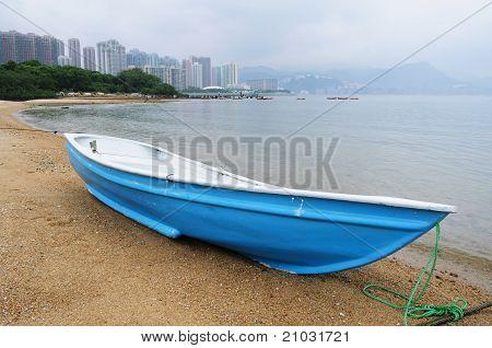 Blue boat on beach