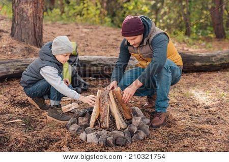 Father And Son Kindling Bonfire