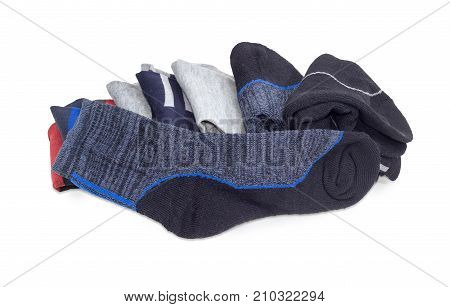 Gray-black men's thermal sock on a background of pile of other different ordinary everyday socks and thermal socks a white background