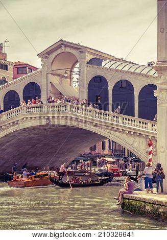 Venice, Italy - May 19, 2017: The old Rialto Bridge over the Grand Canal. Rialto Bridge (Ponte di Rialto) is one of the main tourist attractions of Venice.