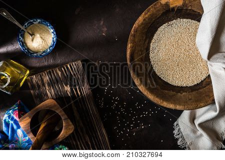 Wooden bowl of sesame seeds and olive oil with a free space horizontal