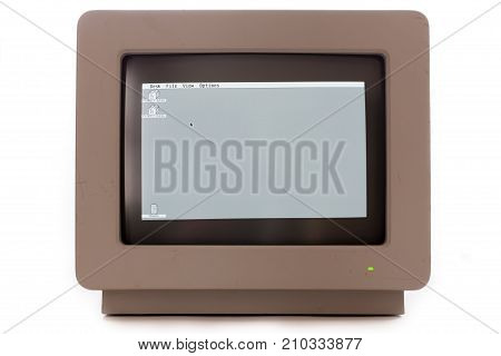 Vintage computer monitor display. Retro cathode ray tube monochrome monitor screen showing floppy disk drive icons and trash can. Isolated against white background.