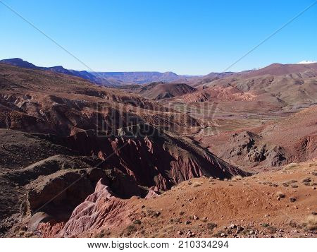 Rocky canyon at high ATLAS MOUNTAINS range landscape in MOROCCO near Tizi-n-Tichka pass in central part of country with clear blue sky in 2017 warm sunny winter day northern AFRICA on February.