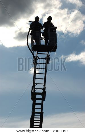 Firefighters On A Ladder